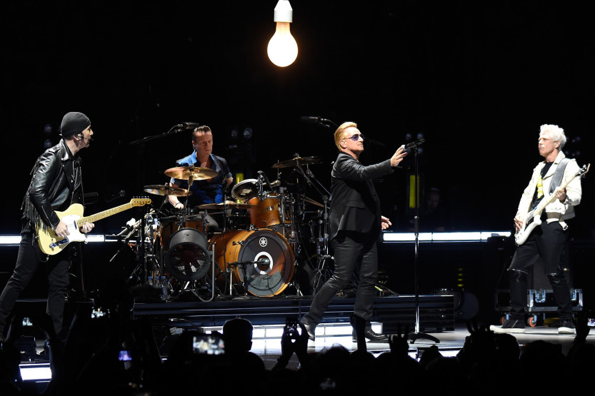 VANCOUVER, BC - MAY 14:  (L-R) Musicians The Edge, Larry Mullen Jr., Bono and Adam Clayton of U2 perform onstage during the U2 iNNOCENCE + eXPERIENCE tour opener in Vancouver at Rogers Arena on May 14, 2015 in Vancouver, Canada.  (Photo by Kevin Mazur/WireImage)